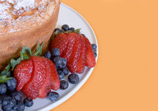 Berries And Cake. Berries and angel food cake with room for text Royalty Free Stock Images