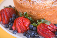 Berries And Cake. Close up of angel food cake with decorative berries Stock Image