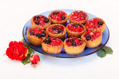 Berries cakes on blue plate Royalty Free Stock Image