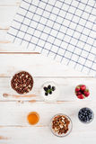 Berries, cereals, nuts, honey and plaid napkin Stock Photo