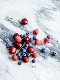 Berries and Cherries on a marble slab