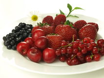 Berries, cherry and red currant. Juicy summer fruits on white isolated background Stock Photo
