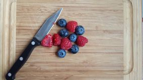 berries on chopping board stock photography