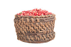 Berries a cowberry in the old basket isolated on white backgroun Stock Photo