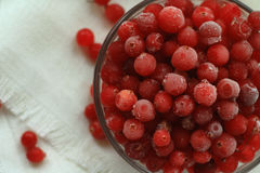 Berries cranberries, frosted, glass plate in front of a white linen cloth, close-up Stock Images