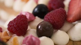 Berries on a cream cake stock video footage