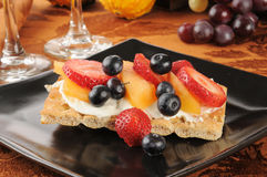 Berries and cream cheese on flatbread crackers Royalty Free Stock Images