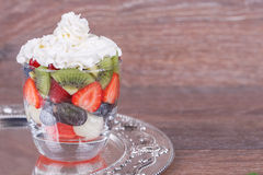 Berries and cream in a glass Stock Photography