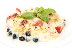 Berries in cream sauce Stock Photography