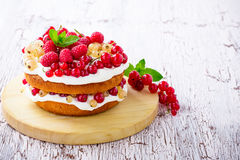 Berries and cream sponge layer cake Royalty Free Stock Photography