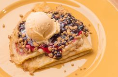 Berries Crumbles Cream Cheese Crepes on top with Vanilla Ice Cream. Closeup Berries Crumbles Cream Cheese Crepes on top with Vanilla Ice Cream stock photography