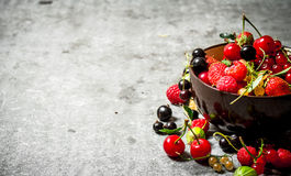 Berries in a Cup. On stone table. Stock Photo