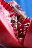 Berries of a cut pomegranate fruit Royalty Free Stock Photo