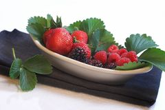 Berries in a dish Stock Photos