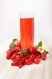 Berries and drink Stock Images