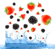 Berries falling in water. Royalty Free Stock Photos