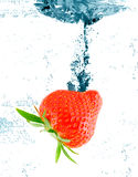 Berries falling in water. stock photo
