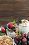 Berries, flakes and fresh greek yogurt Royalty Free Stock Images