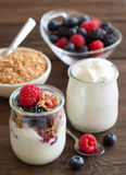 Berries, flakes and fresh greek yogurt. On a wooden table Stock Photography