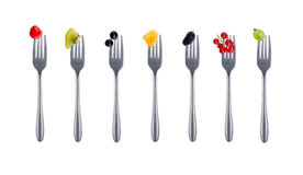 Berries on forks Stock Images