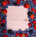 Berries Frame on Wooden Background. Strawberries, Blueberry Royalty Free Stock Photo