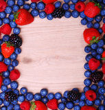 Berries Frame on Wooden Background. Strawberries, Blueberry Royalty Free Stock Photos