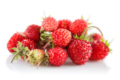 Berries fresh wild strawberries with green leaf Royalty Free Stock Photo