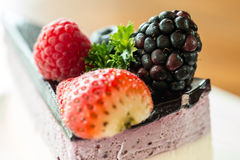 berries on fruit cake Stock Photography