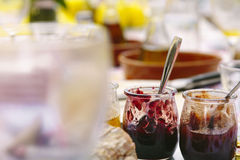 Berries fruit on glass pots on a breakfast table Stock Image