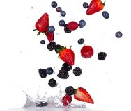 Berries fruit in water splash on white backround Royalty Free Stock Photos
