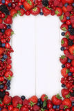 Berries fruits frame with strawberries, blueberries and copyspac Royalty Free Stock Photography