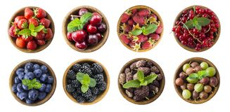 Berries and fruits isolated on white background. Collage of different fruits and berries. Raspberry, strawberry, currant, cherry, stock images