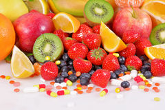 Berries, fruits, vitamins and nutritional supplements Royalty Free Stock Images