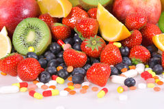 Berries, fruits, vitamins and nutritional supplements Stock Photo