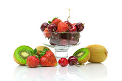 Berries and fruits on white background. horizontal photo. Fresh juicy fruits and berries on a white background with reflection. horizontal photo stock photography