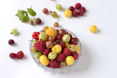 Berries in a glass bowl  (raspberry, cherry, gooseberry) Stock Photo