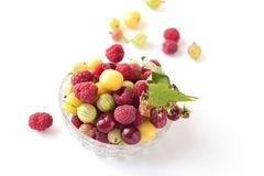 Berries in a glass bowl  (raspberry, cherry, gooseberry) Stock Images