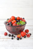 Berries in glass vase Stock Image