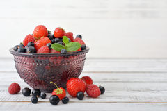 Berries in glass vase Stock Photography
