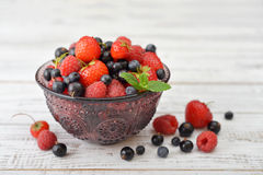 Berries in glass vase Stock Images