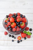Berries in glass vase Royalty Free Stock Photo