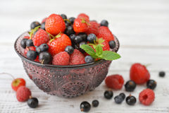 Berries in glass vase Royalty Free Stock Image