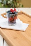 Berries in glass Stock Images