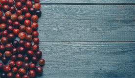 Berries gooseberries on wooden background Stock Photography