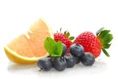 Berries and grapefruit Royalty Free Stock Image