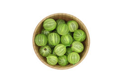Berries green gooseberries in a wooden bowl Royalty Free Stock Images