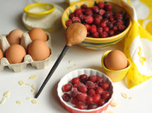 Berries. Handcarved wooden spoon and cranberries Stock Photo