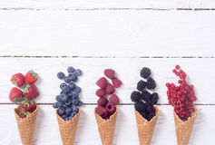 Berries in ice cream cone. Raspberry , blueberry , strawberry , red currant , blackberry Top view with space for text royalty free stock photography