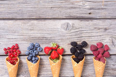 Berries in ice cream cone. Raspberry , blueberry , strawberry , red currant , blackberry Top view with space for text stock images