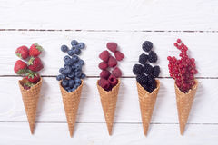 Berries in ice cream cone. Raspberry , blueberry , strawberry , red currant , blackberry Top view with space for text royalty free stock image